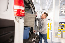 Man Unloading Belongings From Van At Storage Facility Loading Dock