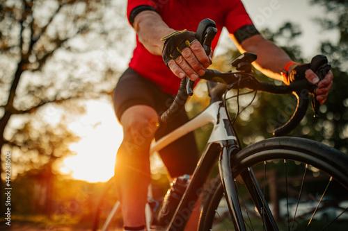 Canvas Print Close up of man riding bike