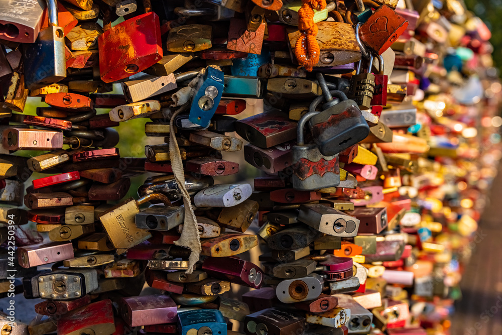 Locks attached to a bridge as a sign of love - COLOGNE, GERMANY