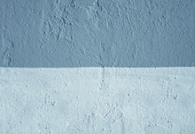 The Wall Is Made Of Blue And Light Blue Plaster.