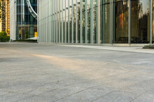 Empty Concrete Ground Floor With Modern Office Buildings.