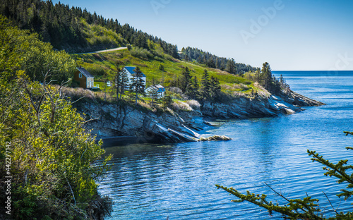 Foto View on the ocean, the cliffs and the Grande Grave farmhouse and barns in Forill