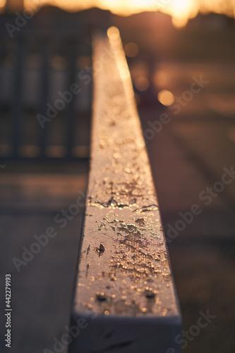 Wooden handrail in sunset Fototapet
