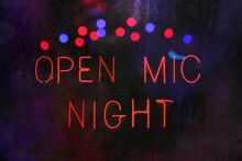 Open Mic Night Sign In Wet Rainy Window