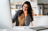 Beautiful business woman working on computer. Business, technology people concept