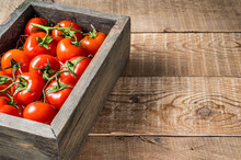 Ripe Red Tomatoes In Wooden Market Box. Wooden Background. Top View. Copy Space