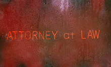 Attorney At Law Neon Sign In Wet Rainy Window