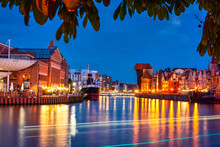 Beautiful Scenery Of Gdansk City At Dusk Over The Motlawa River. Poland