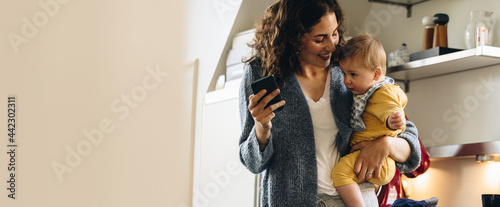 Fotografie, Obraz Woman on maternity leave spending time with her baby