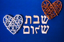 Hebrew Letters Meaning Shabbat Shalom, In English - Peaceful Saturday. On Blue Background