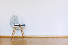 Indoors Flat Wall Mockup With Clothes On Chair