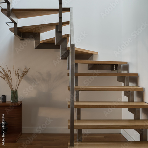 Canvastavla Close-up on modern wooden stairs with silver railing
