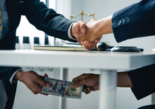 Business People Shaking Hands And Give An Under-the-table Bribe To An Attorney To Help A Lawyer Win A Court Case. Bribery And Kickback Ideas Fraud And Fraud