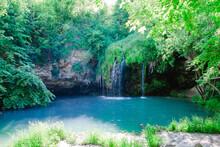 Small Beautiful Waterfall With Blue Lake