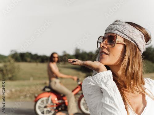 Obraz na płótnie hippie woman having fun with a cricket