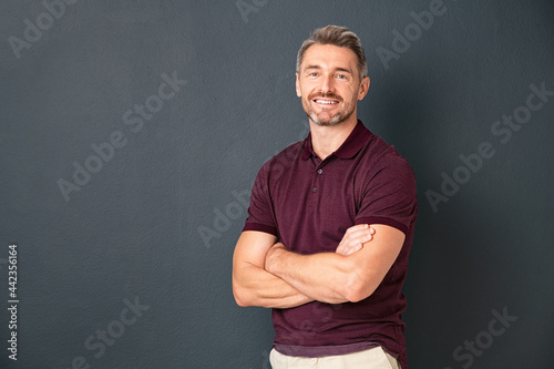 Fotografie, Obraz Happy middle aged man standing isolated on grey background