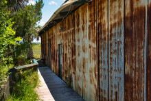 An Old Rusty Metal Shed Beside A Salt Marsh In The Low Country Of Georgia, USA.
