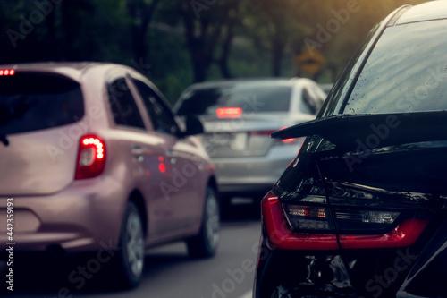 Tela Rear side black car on the road