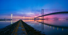 Panoramic Sunrise Over The Forth Bridges Looking Towards Fife, From South Queensferry, Edinburgh, Scotland.