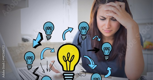 Network of light bulb icons against stressed caucasian woman calculating finance at home
