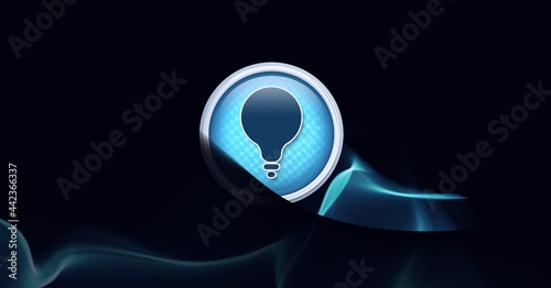 Light bulb icon and digital waves against black technology background