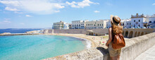 Traveling In Italy. Panoramic View Of Female Backpacker With Hat In Gallipoli Village, Salento, Italy.