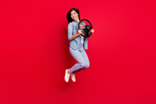 Full Length Body Size View Of Pretty Cheerful Girl Jumping Holding Steering Wheel Way Trip Isolated Over Bright Red Color Background