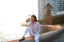 Woman Harbourside In A Happy Mood At Sunrise