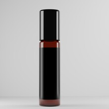Amber Roller Ball Bottle With Black Cap And Blank Label For Mockup
