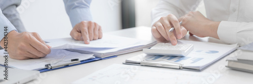Murais de parede Accountant or banker making calculations Bookkeeper Clerk, Bank Advisor And Auditor