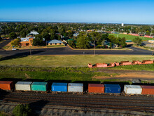 Containers On A Freight Train In Small Aussie Town On Bright Sunlit Morning
