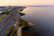 Aerial View Looking Down The Kwinana Freeway And Swan River At Dawn In Perth, Australia.