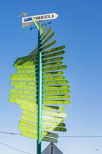 An Elaborate Green Signpost Against A Blue Sky
