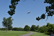 Arlington, VA, USA - June 28, 2021: Commercial Jetliner Approaching Ronald Reagan Washington National Airport To Land As Seen From Gravelly Point Park