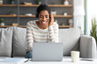Online Meeting. Cheerful Black Lady Wearing Headset having Video Call On Laptop