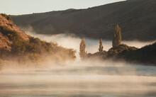 Fog Over The River At Sunrise