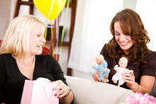 Baby Shower: Guest Playing With Baby Dolls