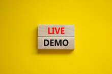 Live Demo Symbol. Concept Words 'live Demo' On Wooden Blocks On A Beautiful Yellow Background. Copy Space. Business And Live Demo Concept.