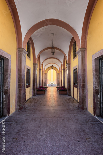 Ancient porch in perspective. The corridor of ancient building.