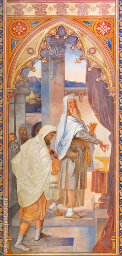 VIENNA, AUSTIRA - JUNI 24, 2021: The fresco of the parable of Pharisee and the tax collector in the Votivkirche church by brothers Carl and Franz Jobst (sc Fototapeta