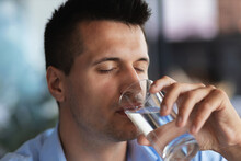 Caucasian Young Man Drinking Water From A Glass Glass Close Up