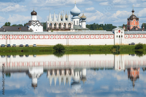 Fotografia, Obraz Ancient belfry in the complex of buildings of the Tikhvin Theotokos Assumption Monastery on July afternoon