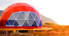 Red Geo-dome Tent On Kamchatka Peninsula. Cozy, Camping, Glamping, Holiday, Vacation Lifestyle Concept. Outdoors Cabin, Scenic Background