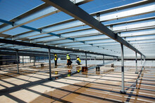 Metal Framework And Workers On An Industrial Building Site