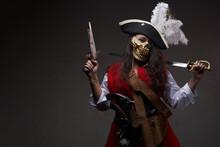 Tattooed Female Pirate Posing With Cutlass And Gun
