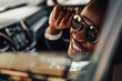 Stylish black businessman with sunglasses inside of car