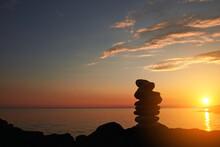 Zen Stones On A Ocean Sea Cliff In Sunset Sunrise Time.