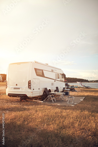 Slika na platnu Camper van house camp near the ocean sea shore.