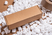 Cardboard Box On Loose White Filler Shipping Packing Peanuts