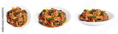 Fotografia Stir fried spicy cat fish in white ceramic dish on white background